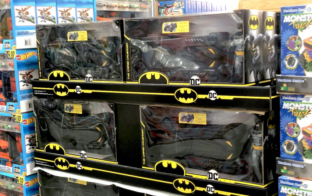 black batmobile sets sitting in boxes stacked in store aisle