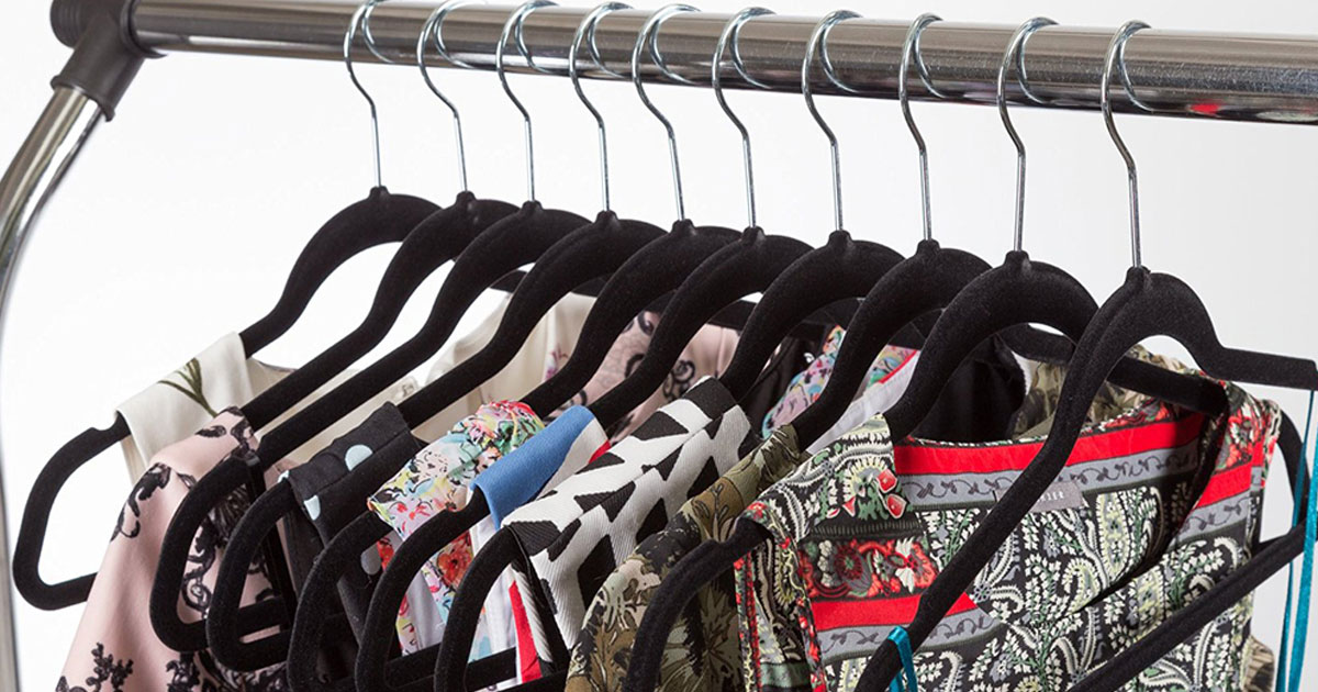 women's clothing hung on a rack with black velvet hangers from zulily