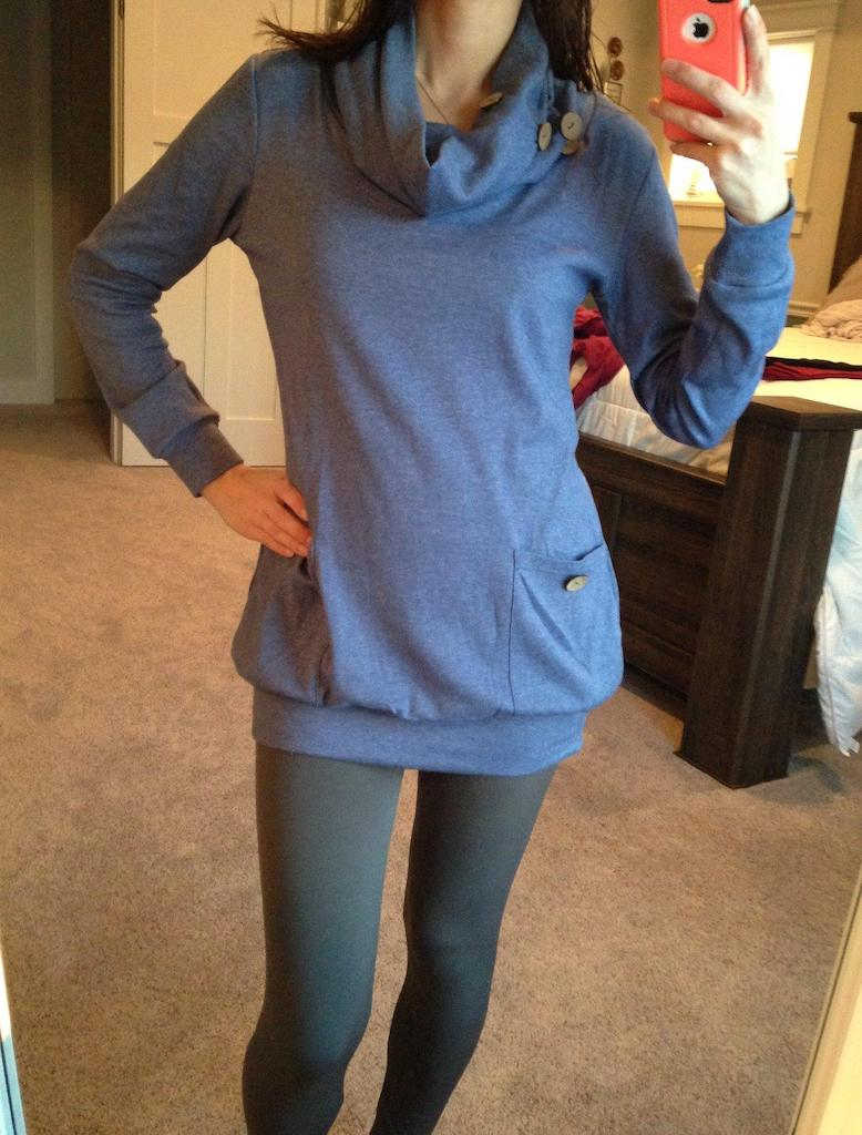 women wearing blue cowl neck top with leggings