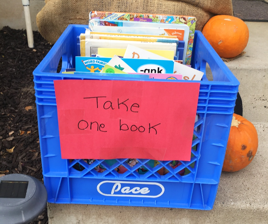 Donated book in bin on porch for Halloween