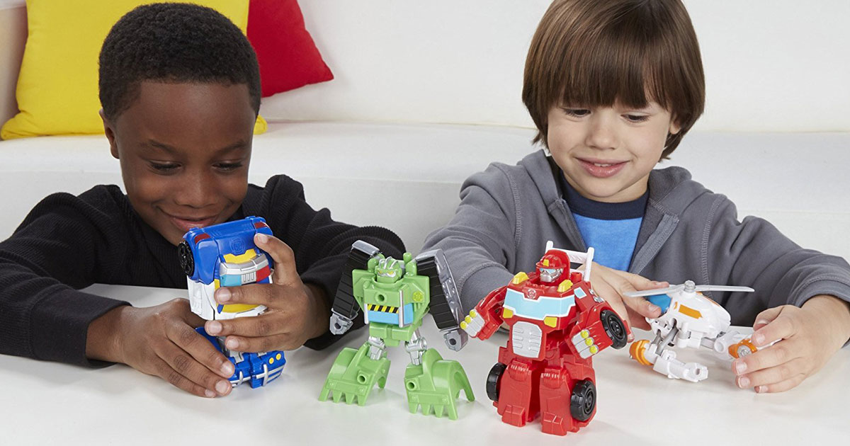 little boys playing with Playskool Rescue Hero Bots