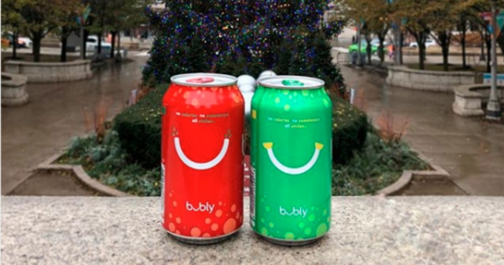 Two cans of Bubly brand sparkling water outside