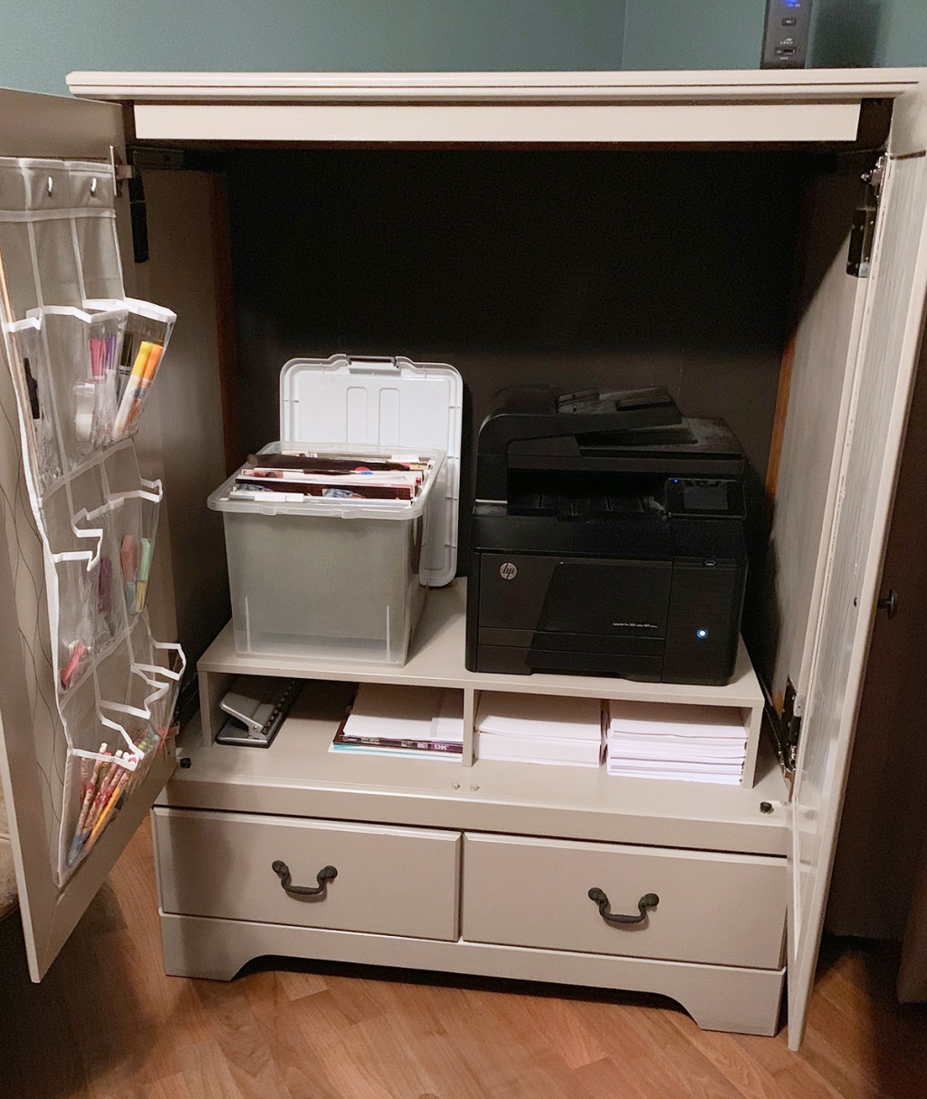 Finished wardrobe cabinet with printer and school supplies