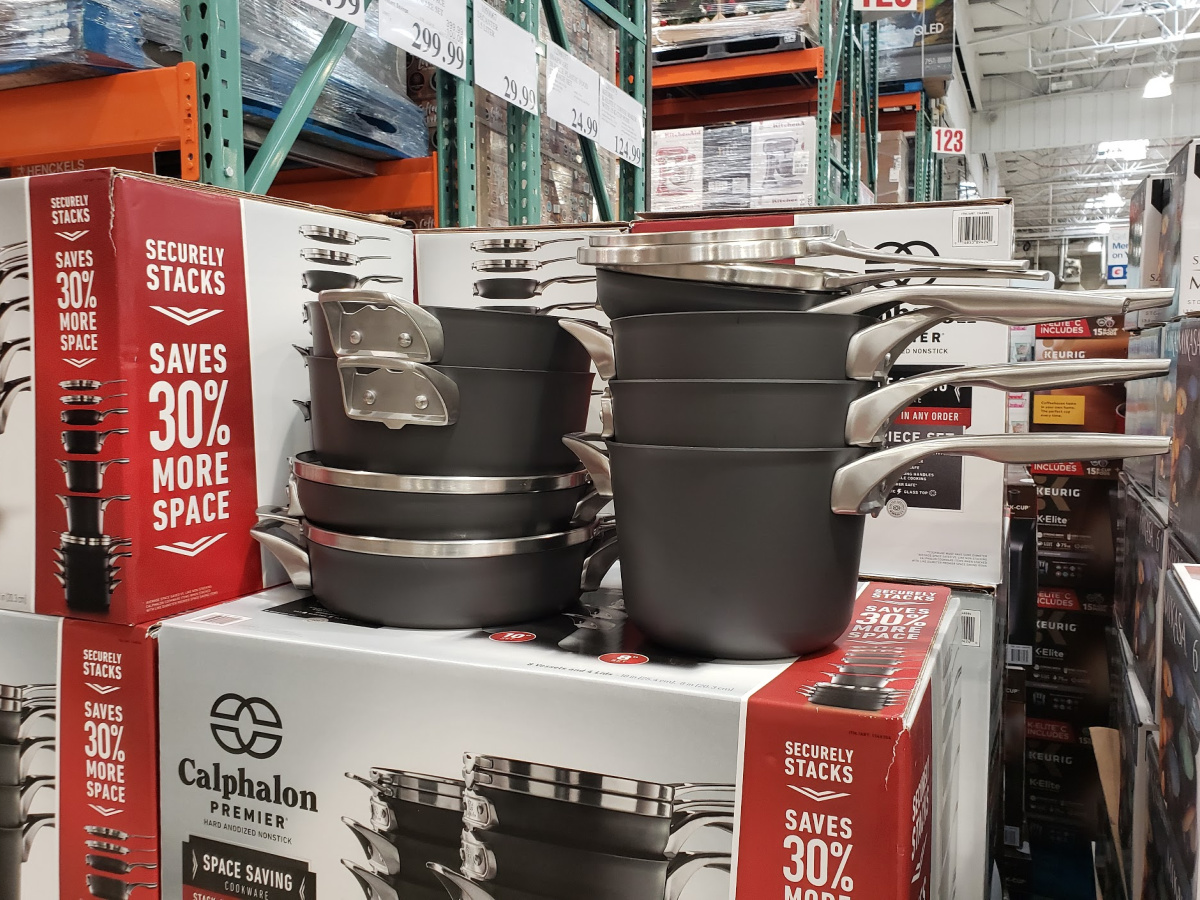 Calphalon pots stacked on top of a box