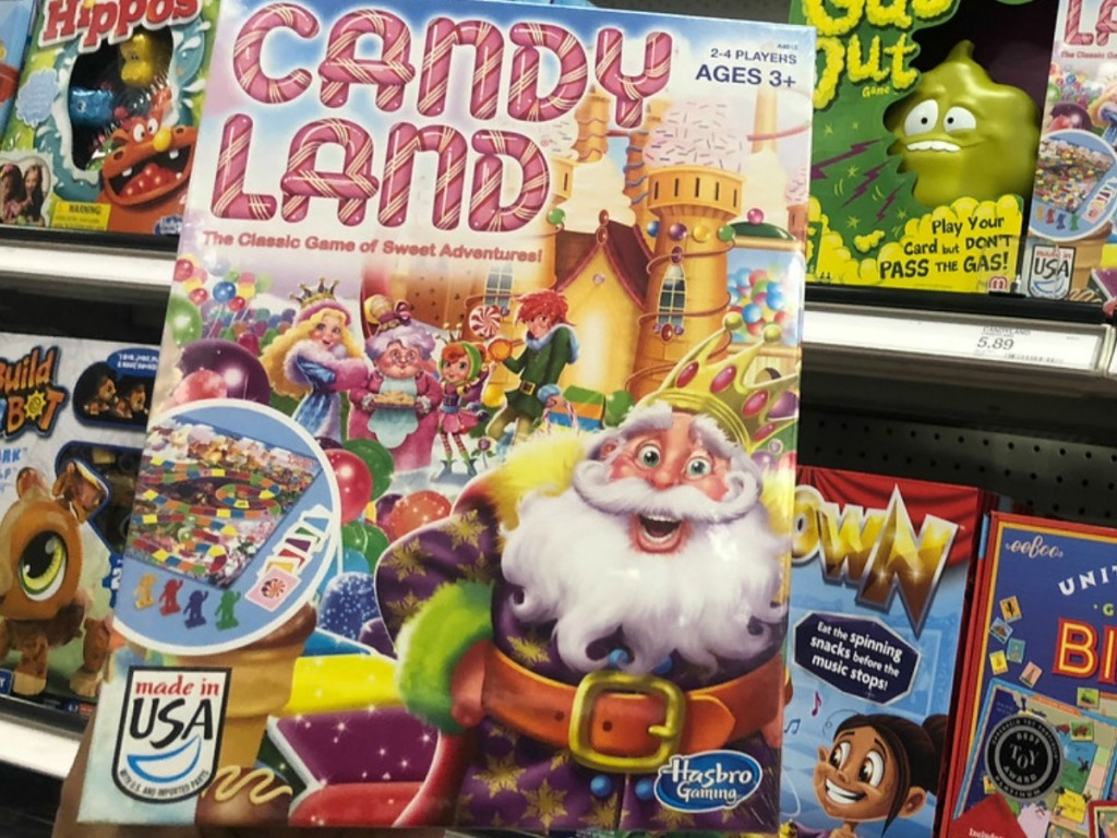 hand holding game of candy land by store display