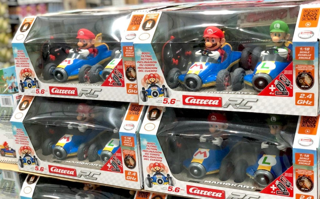 mario and luigi race cars in boxes stacked on store floor