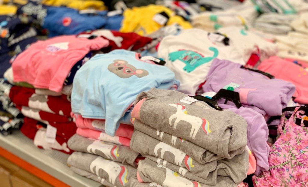 piles of random character pajama sets carters
