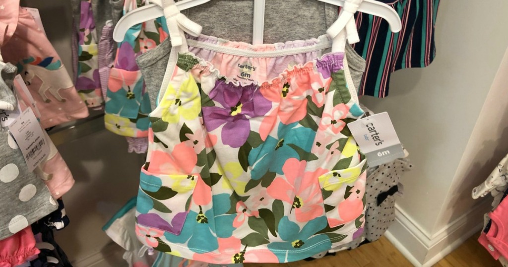 tank top with flowers on hanger in store