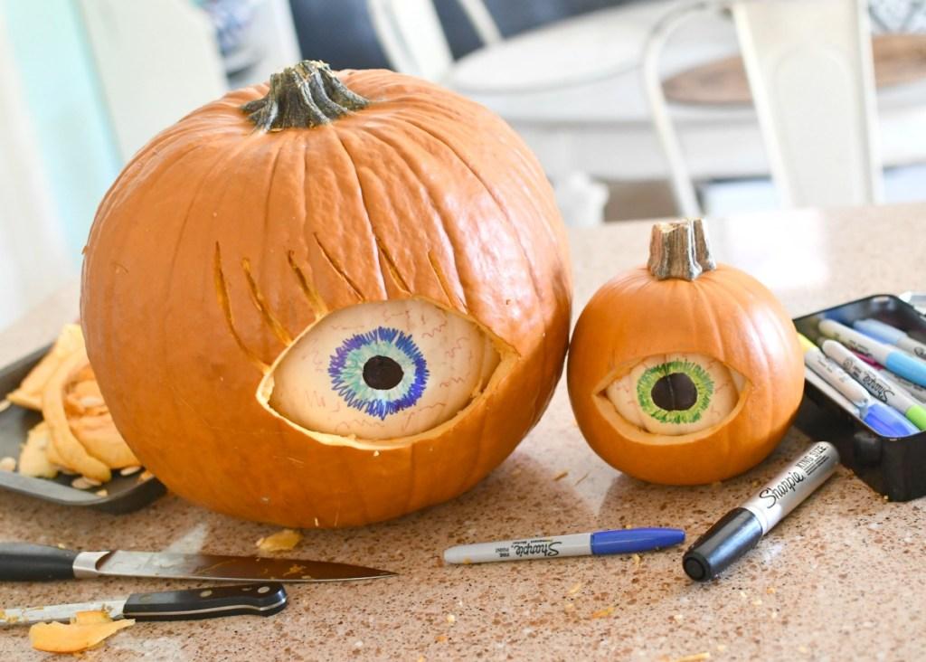 carving eye pumpkins using two pumpkins