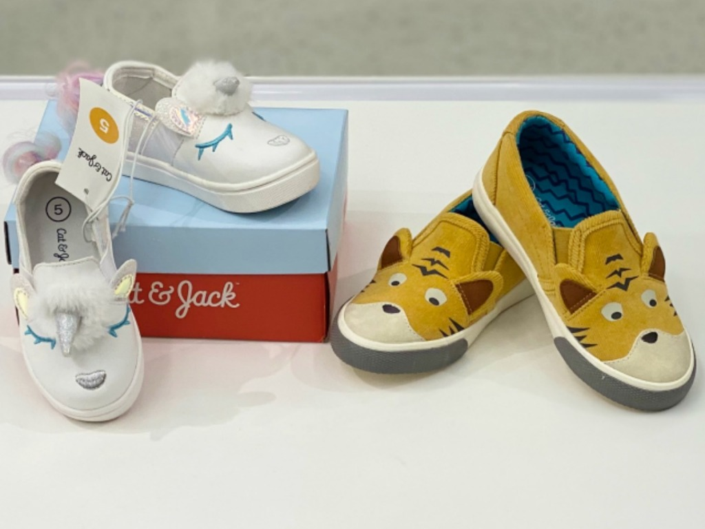 little pair of white shoes and tiger orange kids shoes