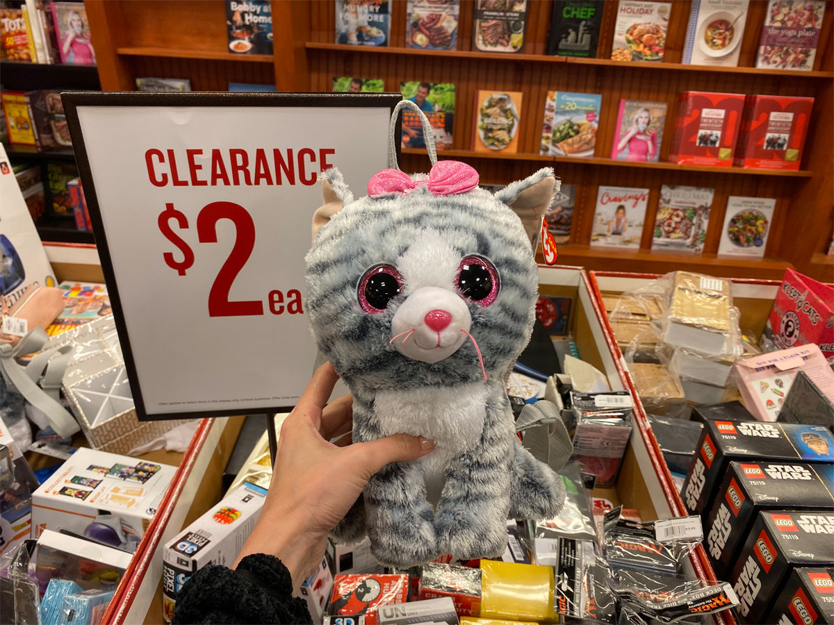 plush cat with pink bow on it's head