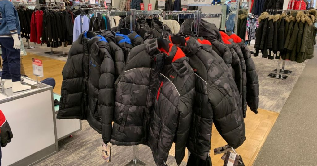 gray and black camo puffer jacket hanging in store