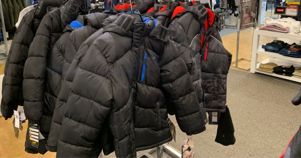black and blue puffer jacket hanging in store