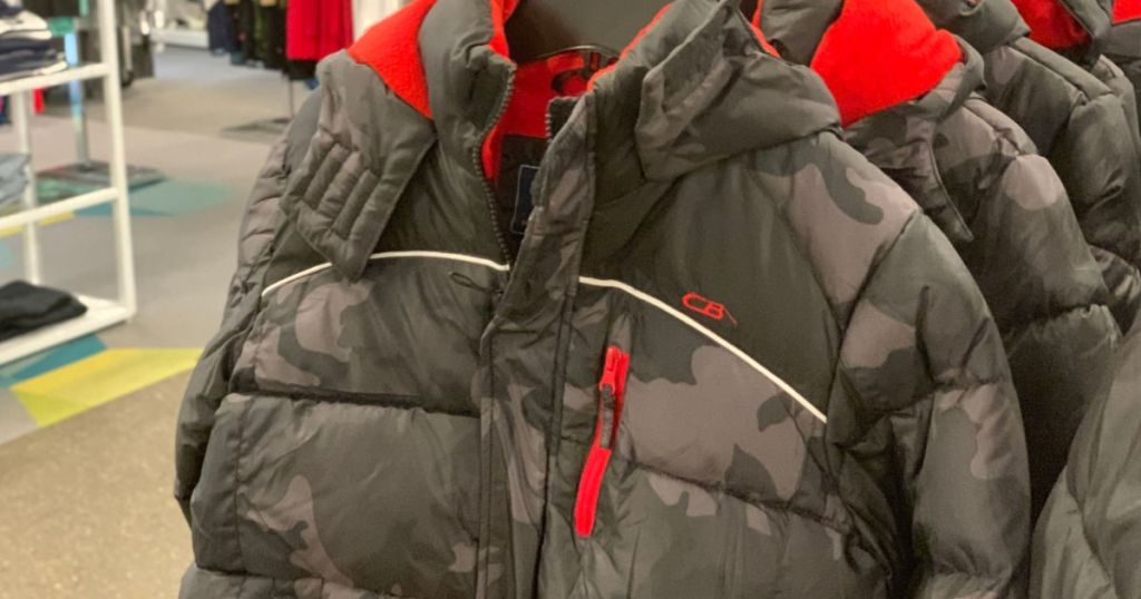 grey and black camo puffer jacket hanging in store