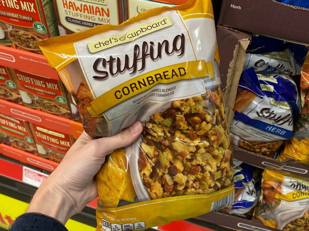 hand holding bag of stuffing by store display