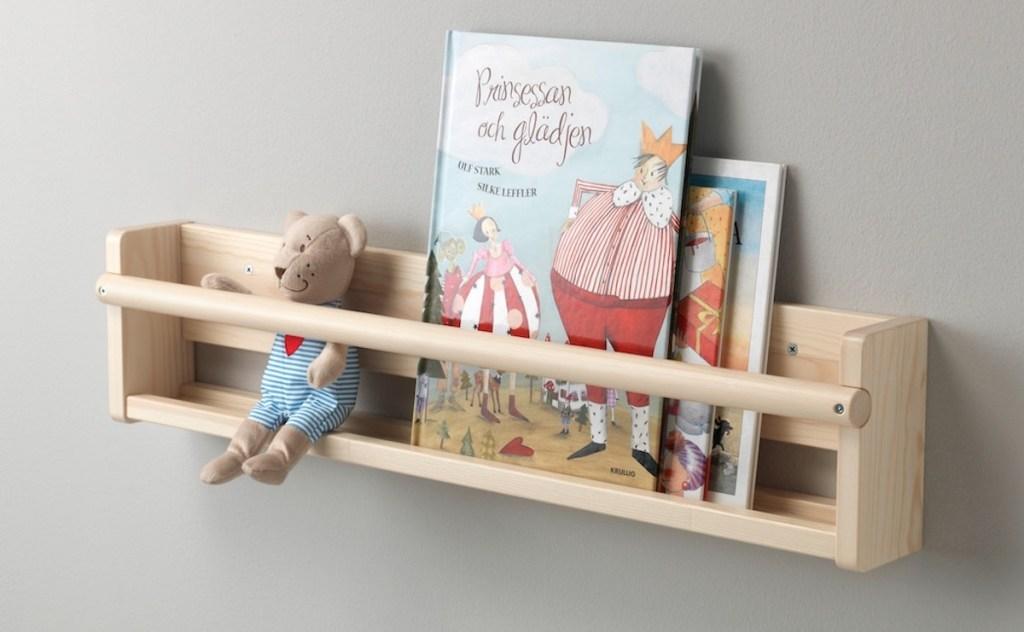 wooden bookshelf stuffed animal