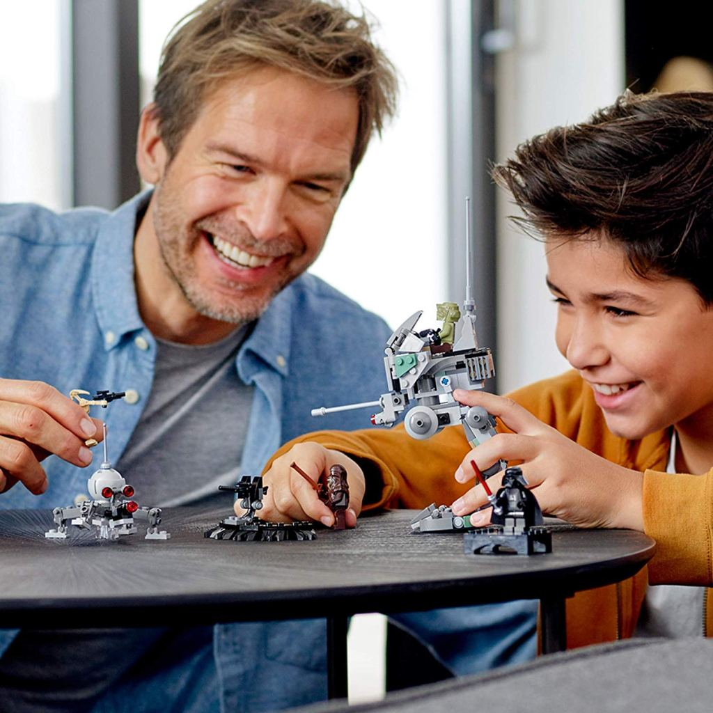 Boy and Dad playing with LEGO clone scout