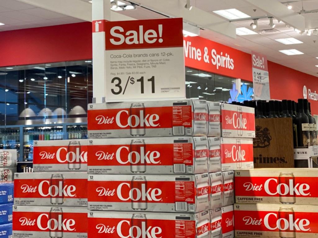 coca cola sale sign on top of diet coke display