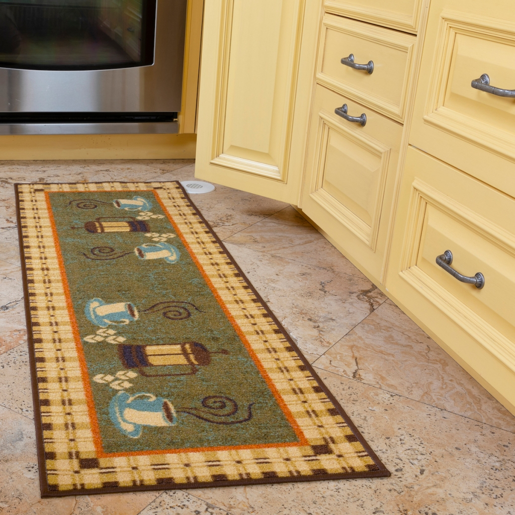 coffee cups runner rug in front of kitchen cabinets
