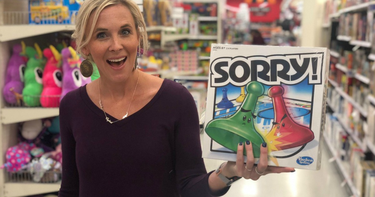 woman holding sorry board game in store