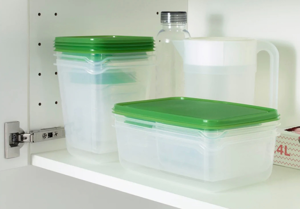 green and clear food containers stacked inside cabinet