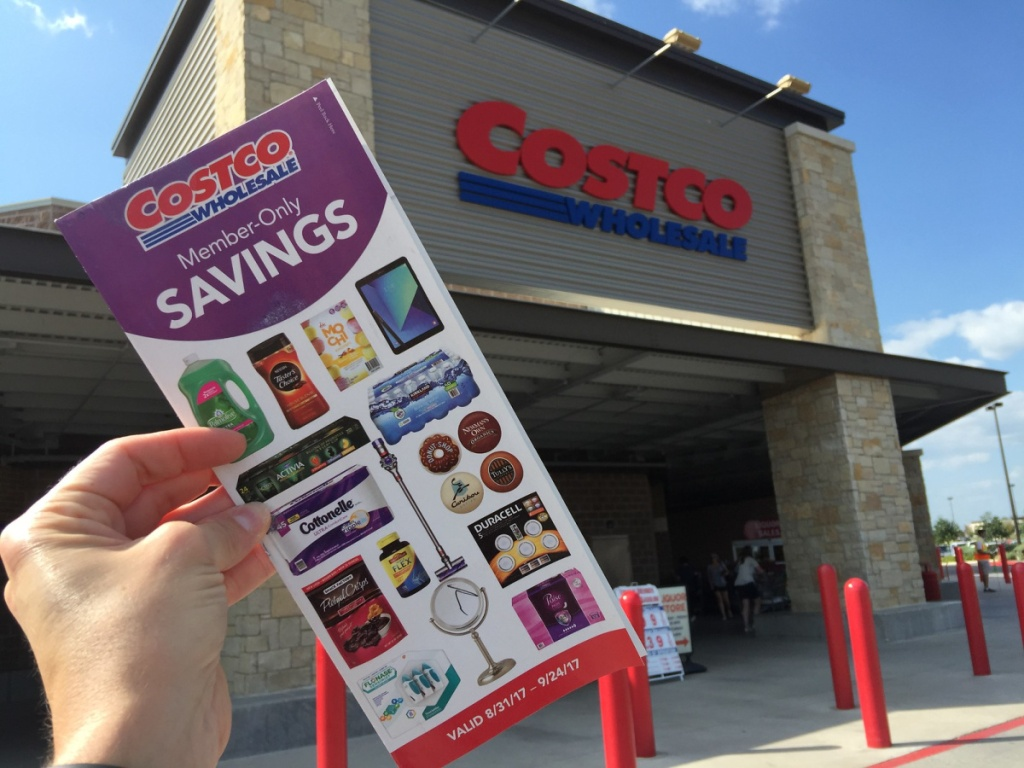 costco member only pamphlet in front of costco building