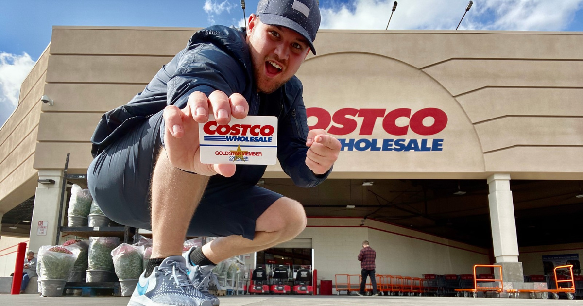 stetson holding costco membership in front of costco building
