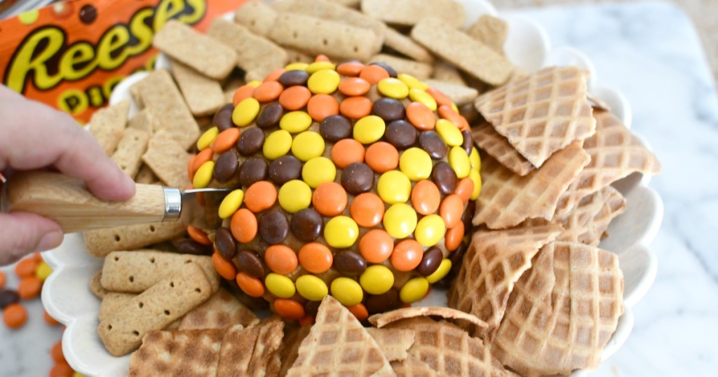 cutting into a Reese's peanut butter ball