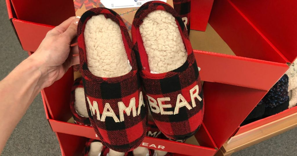 hand holding up mama bear slippers in store
