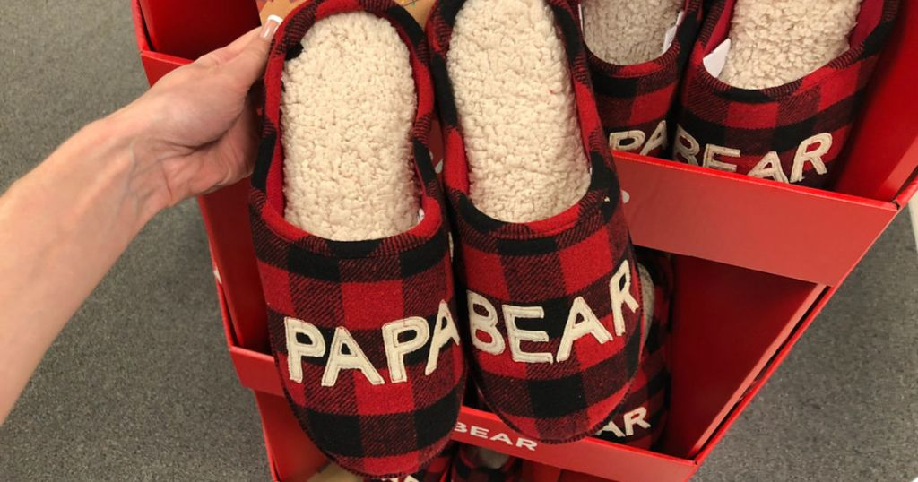 hand holding papa bear slippers in store