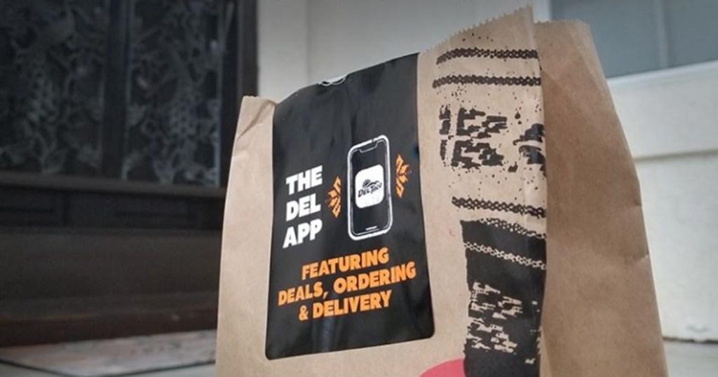 Del Taco bag on doorstep