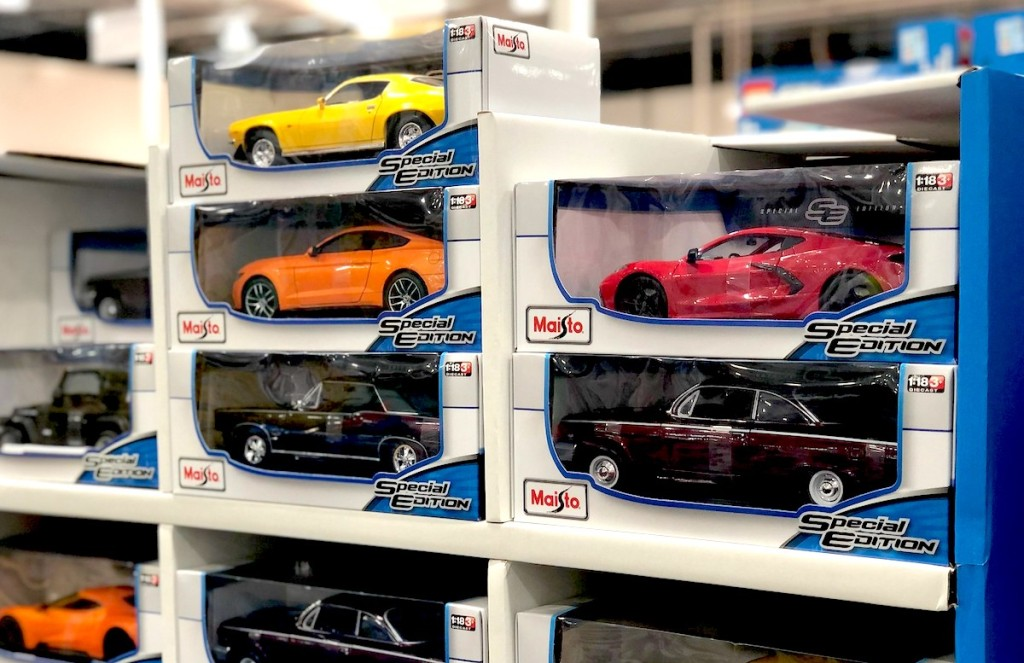colorful race cars stacked on top of each other in store