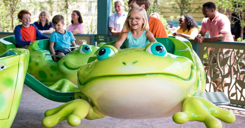 PreK little girl riding frog at Dollywood