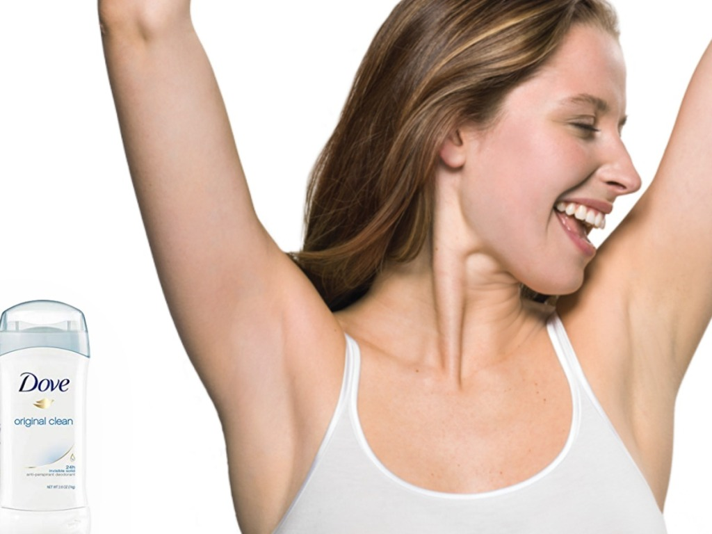 woman holding arms up next to deodorant