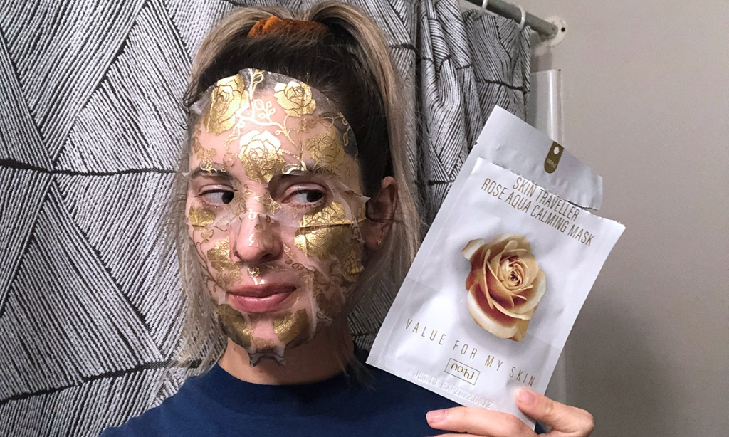 Emily wearing gold foil sheet mask from Facetory