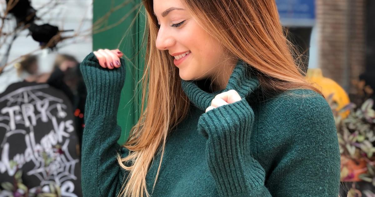 woman wearing emerald turtleneck sweater outside