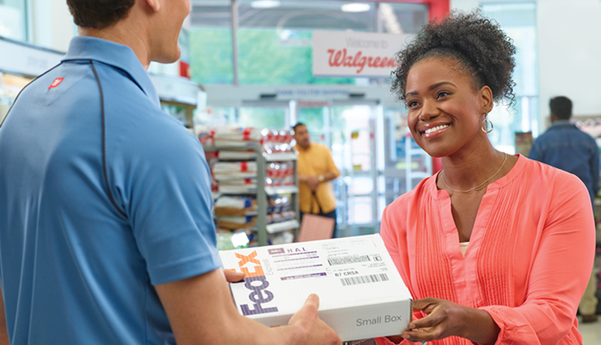 woman getting a FedEx package at Walgreens