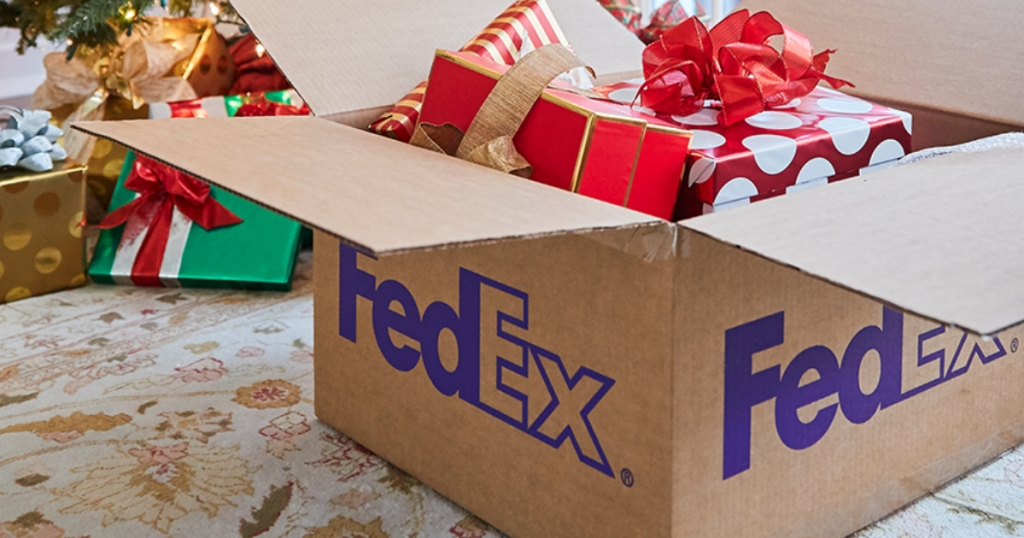 FedEx box filled with gifts