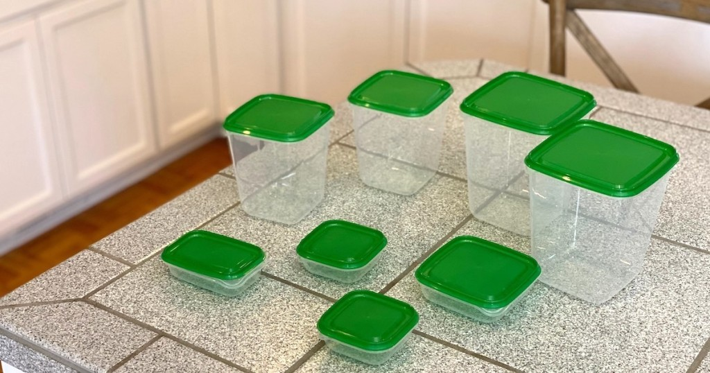 green and clear food containers sitting on gray tiled counter