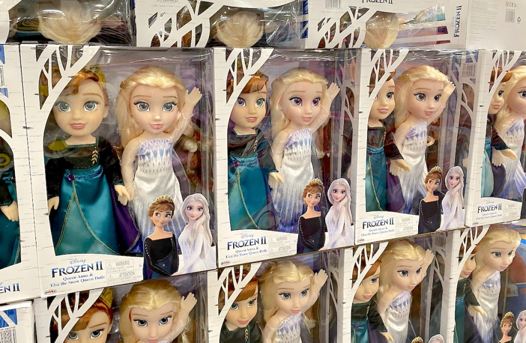 elsa and anna frozen dolls in boxes stacked in pile at store