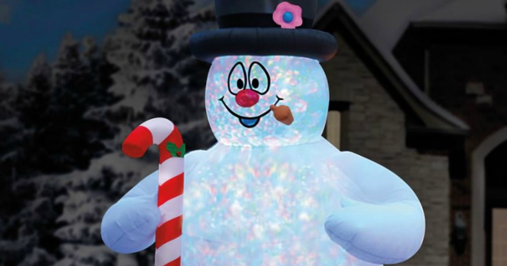 inflatable snowman with candy cane and pipe