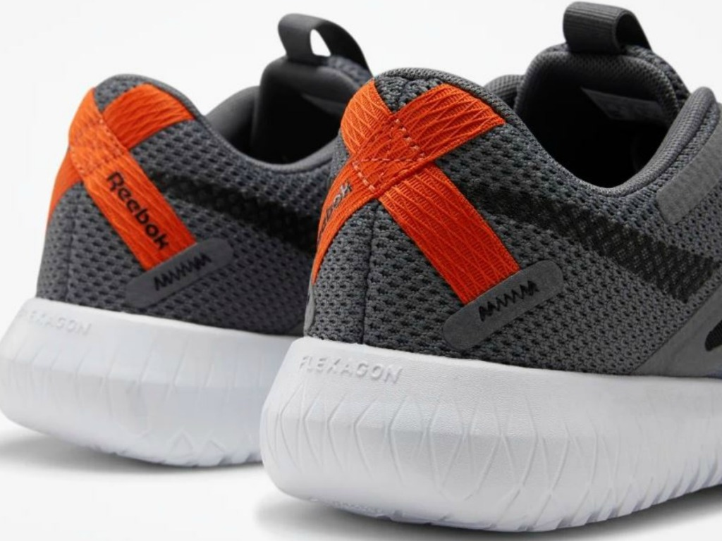 pair of back of shoes that are grey and orange