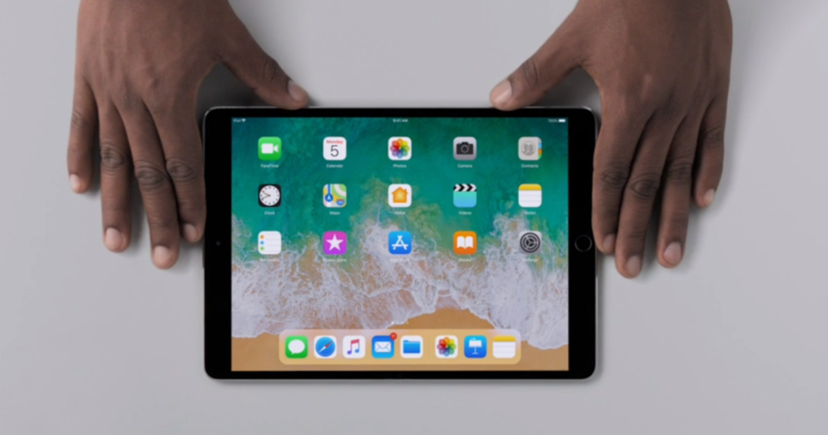 hands holding iPad