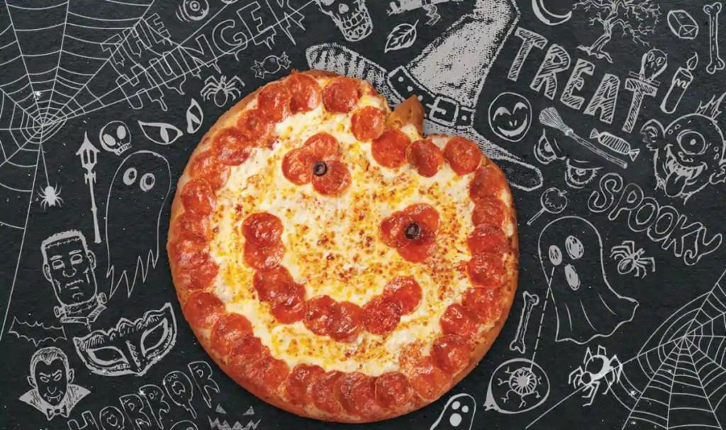 Jack-O-Lantern Pizza on chalkboard at Papa John's