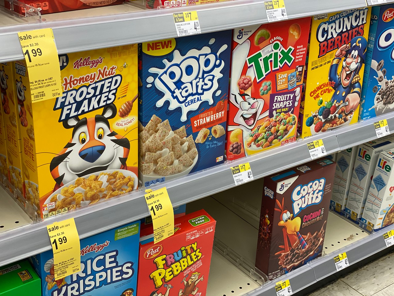 Kellogg's Cereals on Walgreens sehlf with sale tags