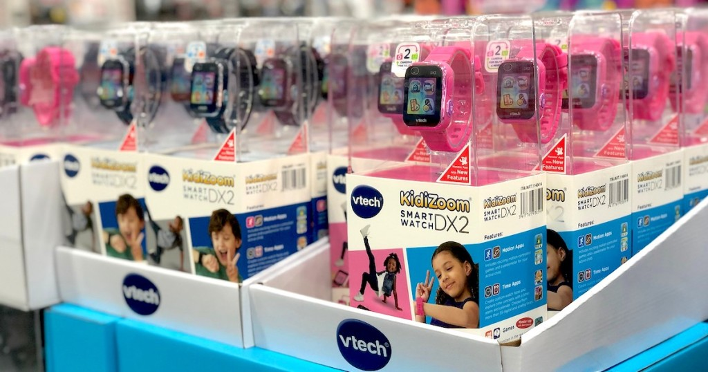 vtech kidizoom watches pink and black in boxes stacked on store shelf