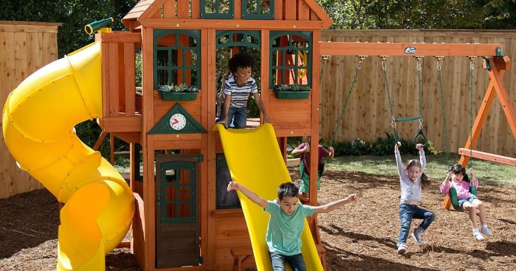 kids playing on kidkraft orchard view manor playset