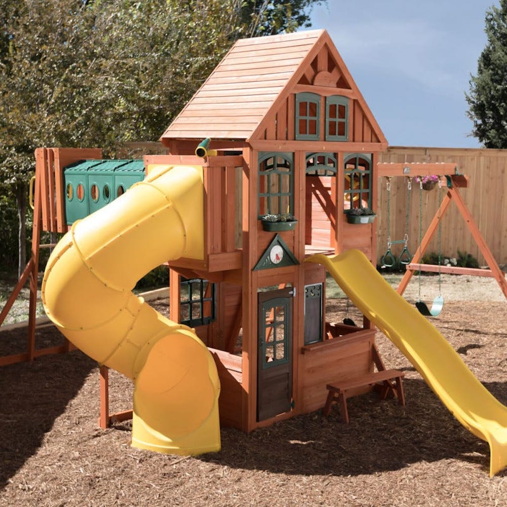 kidkraft orchard view manor playset in back yard