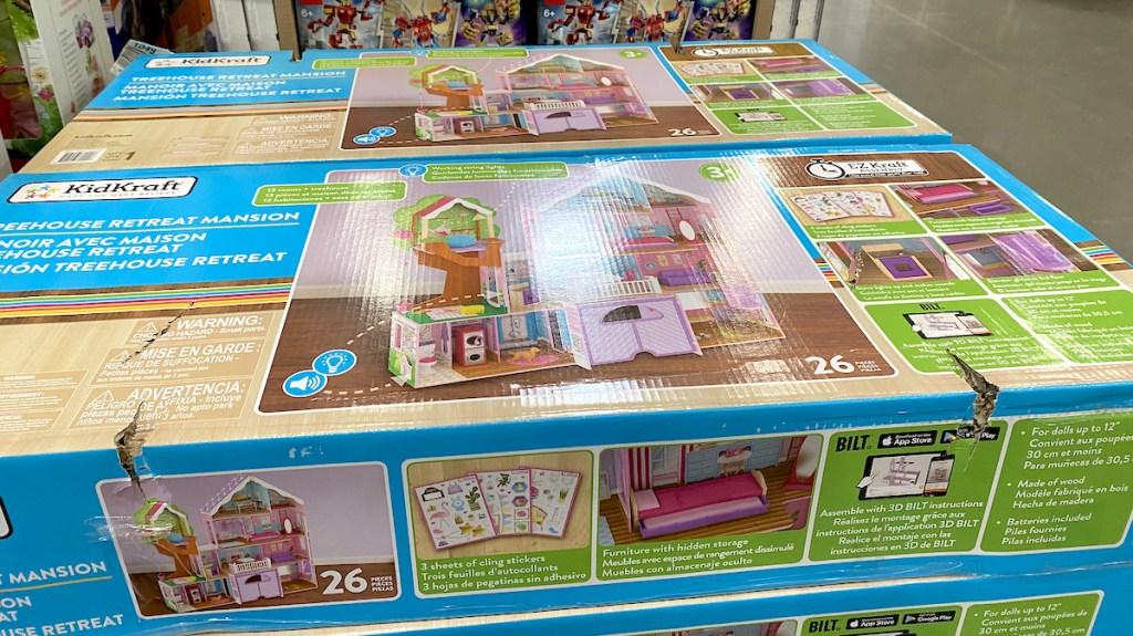 kidkraft treehouse playset in box sitting on store floor