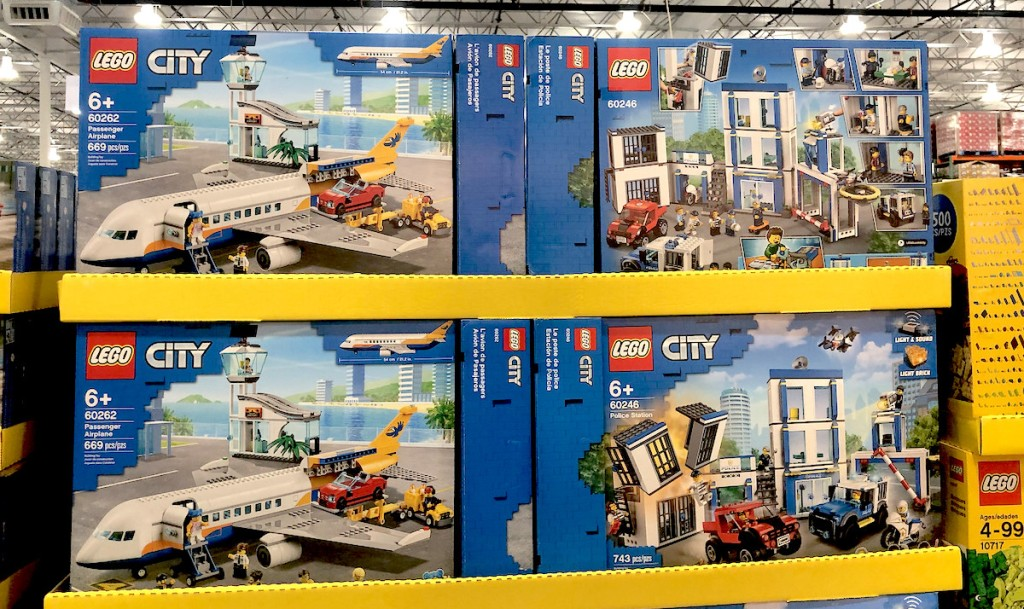 lego city building sets stacked on store shelf